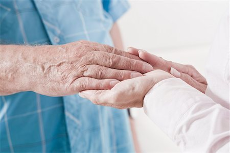 Close-up of Caregiver holding Patient's Hand Stock Photo - Premium Royalty-Free, Code: 600-03907112