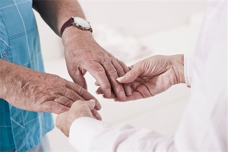 dependable - Close-up of Caregiver holding Patient's Hands Stock Photo - Premium Royalty-Free, Code: 600-03907113