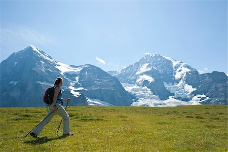 snow capped - Woman Hiking using Walking Sticks, Bernese Oberland, Switzerland Stock Photo - Premium Royalty-Free, Code: 600-03907122