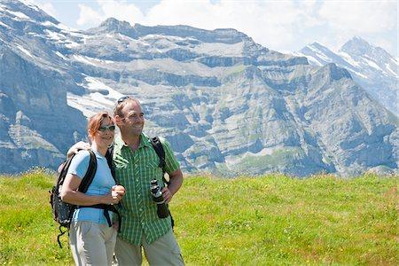 Couple Looking at View, Bernese Oberland, Switzerland Stock Photo - Premium Royalty-Free, Code: 600-03907135