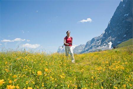 Woman Hiking, Berense Oberland, Eiger Peak, North Face, Switzerland Stock Photo - Premium Royalty-Free, Code: 600-03907139