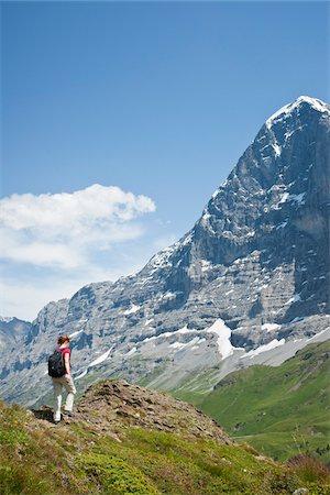 Woman Hiking, Berense Oberland, Eiger Peak, North Face, Switzerland Stock Photo - Premium Royalty-Free, Code: 600-03907140