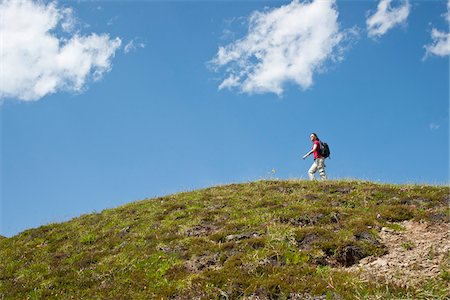 Woman Hiking on Mountain Top, Bernese Oberland, Switzerland Stock Photo - Premium Royalty-Free, Code: 600-03907141