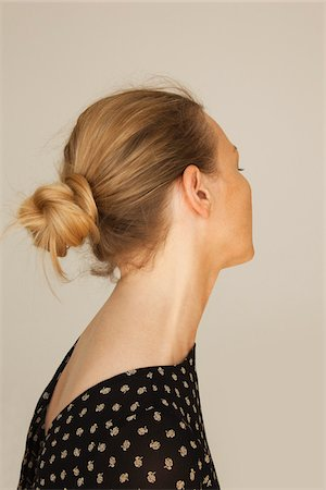 Woman with Hair in Bun Stock Photo - Premium Royalty-Free, Code: 600-03907655