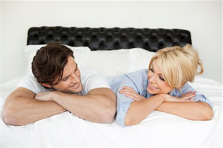 Couple lying on bed, portrait Stock Photo - Premium Royalty-Free, Code: 614-05399523