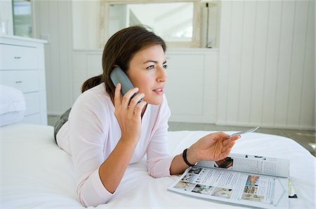 person on phone with credit card - Woman home shopping on phone with credit card Stock Photo - Premium Royalty-Free, Code: 614-05399672