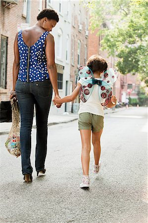 Mother and daughter walking along street, rear view Stock Photo - Premium Royalty-Free, Code: 614-05522930