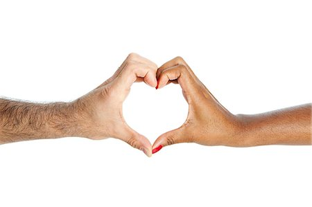 partnership - Mixed race couple making heart shape with hands Stock Photo - Premium Royalty-Free, Code: 614-05523000