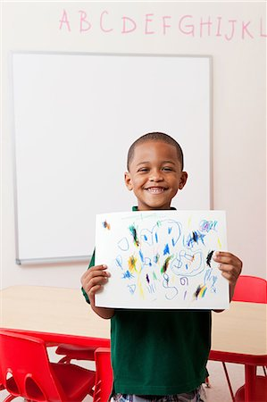 draw - Boy holding picture that he has drawn in school Stock Photo - Premium Royalty-Free, Code: 614-05523156