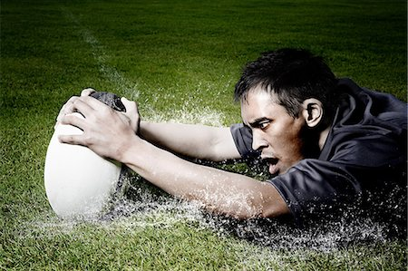 scoring - Rugby player on wet field Stock Photo - Premium Royalty-Free, Code: 614-05523162