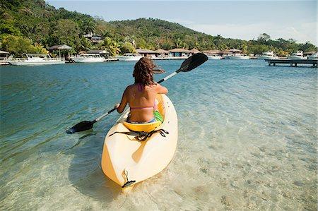 Young woman kayaking in sea Stock Photo - Premium Royalty-Free, Code: 614-05556891