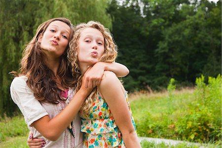 pucker - Teenage girls fooling around and puckering lips Stock Photo - Premium Royalty-Free, Code: 614-05556995