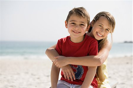 preteen beach - Brother and sister embracing on a beach Stock Photo - Premium Royalty-Free, Code: 614-05557172