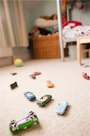 dangerous accident - Toy cars scattered across a child's bedroom Stock Photo - Premium Royalty-Free, Code: 614-05650615