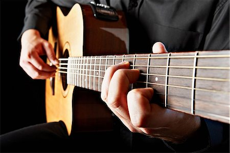 Close up of person playing classical guitar Stock Photo - Premium Royalty-Free, Code: 614-05650715