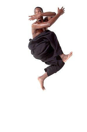 Dancer in mid air pose Stock Photo - Premium Royalty-Free, Code: 614-05650897