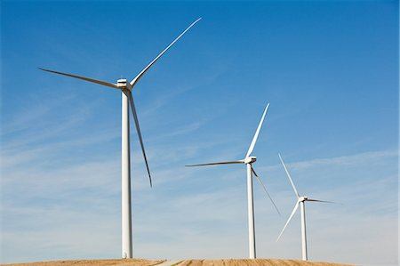 Three wind turbines side by side Stock Photo - Premium Royalty-Free, Code: 614-05650963