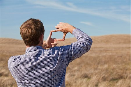 rectangle - Man using hands to frame landscape Stock Photo - Premium Royalty-Free, Code: 614-05650982