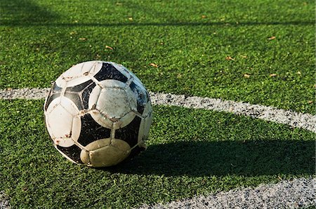 Close up of a ball on a football pitch Stock Photo - Premium Royalty-Free, Code: 614-05662157