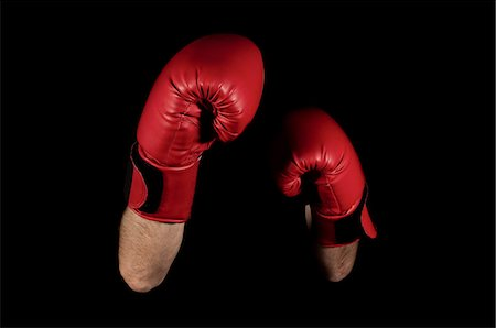 Close up of boxers' arms and gloves Stock Photo - Premium Royalty-Free, Code: 614-05662161