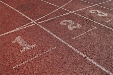 race track (people) - Close up of running track start lines Stock Photo - Premium Royalty-Free, Code: 614-05662163