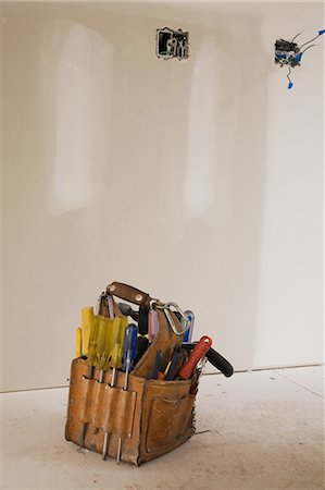 Tool bag on the floor of unfinished room Stock Photo - Premium Royalty-Free, Code: 614-05662266