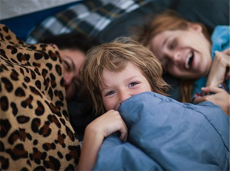 Mother and children in a tent Stock Photo - Premium Royalty-Free, Code: 614-05792047