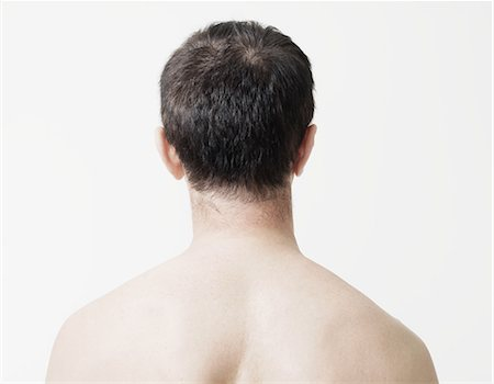 Head and shoulders of man, rear view Stock Photo - Premium Royalty-Free, Code: 614-05792287