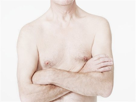 Man with bare chest and arms crossed Stock Photo - Premium Royalty-Free, Code: 614-05792293