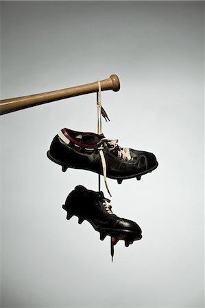 pair - Shoes hanging from baseball bat Stock Photo - Premium Royalty-Free, Code: 614-05792440