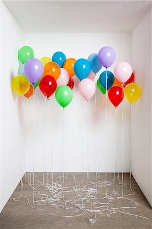 Colorful balloons in a room Stock Photo - Premium Royalty-Free, Code: 614-05792522