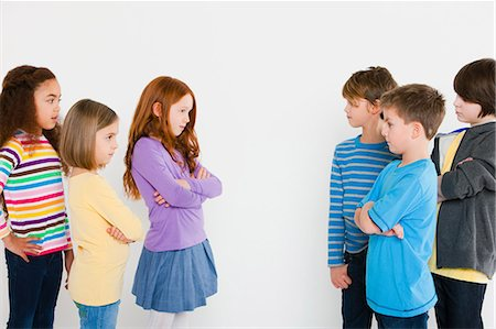 Girls and boys confronting each other Stock Photo - Premium Royalty-Free, Code: 614-05818944