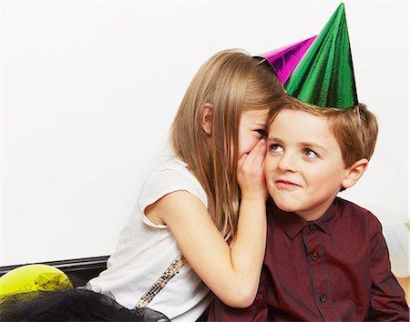 Girl whispering to boy Stock Photo - Premium Royalty-Free, Code: 614-05819076