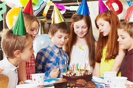 Children around cake at birthday party Stock Photo - Premium Royalty-Free, Code: 614-05819077