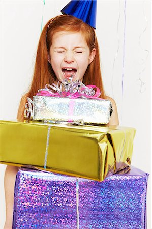 Screaming girl with stack of birthday gifts Stock Photo - Premium Royalty-Free, Code: 614-05819070