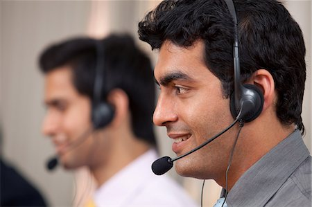 Call center agent smiling Stock Photo - Premium Royalty-Free, Code: 614-05955221