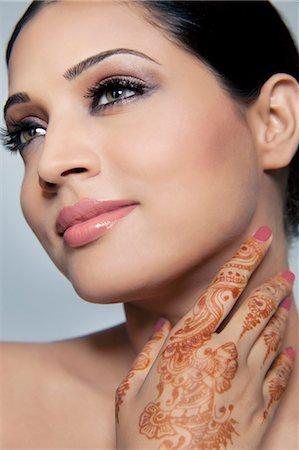Beautiful woman with mehndi Stock Photo - Premium Royalty-Free, Code: 614-05955244