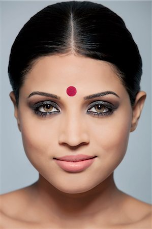 Portrait of a beautiful woman with a bindi Stock Photo - Premium Royalty-Free, Code: 614-05955261