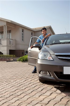 east indian (male) - Portrait of a man next to his car Stock Photo - Premium Royalty-Free, Code: 614-05955271