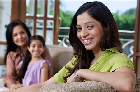 east indian mother and children - Portrait of a woman on a sofa Stock Photo - Premium Royalty-Free, Code: 614-05955284
