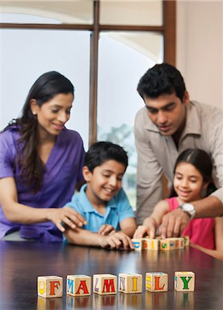 east indian mother and children - Family playing with building blocks Stock Photo - Premium Royalty-Free, Code: 614-05955296