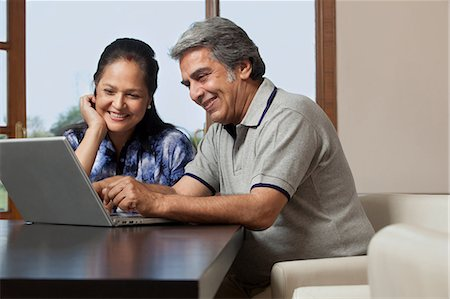 Old couple with a laptop Stock Photo - Premium Royalty-Free, Code: 614-05955290