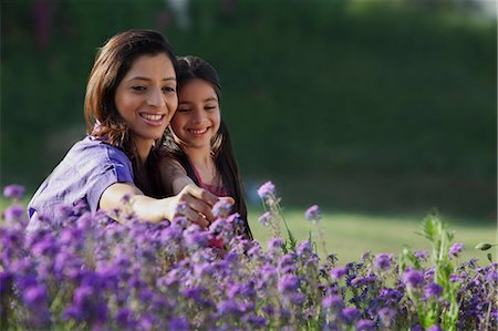 east indian mother and children - Mother and daughter plucking flowers Stock Photo - Premium Royalty-Free, Code: 614-05955304