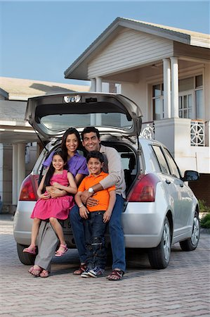 east indian mother and children - Family sitting at the back of a car Stock Photo - Premium Royalty-Free, Code: 614-05955306