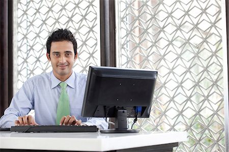 east indian (male) - Executive working on a computer Stock Photo - Premium Royalty-Free, Code: 614-05955327