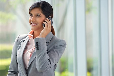 Businesswoman talking on a mobile phone Stock Photo - Premium Royalty-Free, Code: 614-05955332