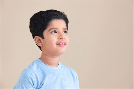 east indian (male) - Young boy looking up Stock Photo - Premium Royalty-Free, Code: 614-05955350