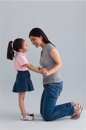 east indian mother and children - Mother and daughter having fun Stock Photo - Premium Royalty-Free, Code: 614-05955366