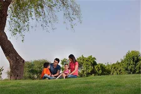 pregnant asian - Family sitting in a park Stock Photo - Premium Royalty-Free, Code: 614-05955375