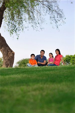 pregnant asian - Portrait of a family in a park Stock Photo - Premium Royalty-Free, Code: 614-05955376